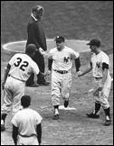May 6, 1962: Mickey Mantle is congratulated by Roger Maris and Elston Howard (32) after he belts his third home run of the day in a doubleheader at Yankee Stadium against the Senators. Roger Maris hit back-to-back home runs with Mickey in the second game.