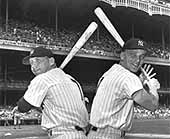 Mickey Mantle and friend and teammate Roger Maris - the M&M Boys - display their batting stances back-to-back in 1961, the year Maris broke Babe Ruth's single season home run record and Mantle hit 54 home runs, the most ever by teammates.