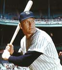 Color photo of Mickey Mantle posing in his right-handed batting stance at Yankee Stadium in New York