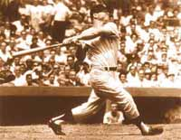 Mickey Mantle's classic left-handed home run power swing, showing Mickey belting a long home run at Yankee Stadium in New York