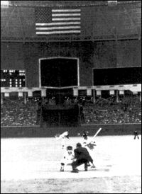 Mickey Mantle waits for the pitch from Astros pitcher Turk Farrell that he belted to centerfield for the first home run ever hit in the Houston Astrodome.