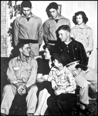 "Mickey Mantle with his family: father Elvin ""Mutt"" Mantle, twins Ray & Roy, sister Barbara, brother Butch, and mother Lovell."