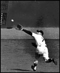 Oct. 8, 1956: Mickey Mantle races after Gil Hodges' line drive to deep left-centerfield in Game 5 of the 1956 World Series at Yankee Stadium. Mickey made a spectacular back-handed catch to rob Hodges of an extra-base hit to save Don Larsen's perfect game, the only perfect game in World Series history. Mantle also homered to give the Yankees their first run.