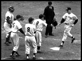 Yankees players, led by Yogi Berra, greet Mickey Mantle after he belted a grand slam into the upper deck in left-centerfield at Ebbets Field in Brooklyn, leading the Yankees to an 11-7 win over the Dodgers in Game 5 of the World Series on Oct. 4, 1953.